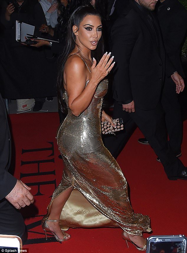 Strutting her stuff: Kim looked incredible as she sauntered down the red carpet