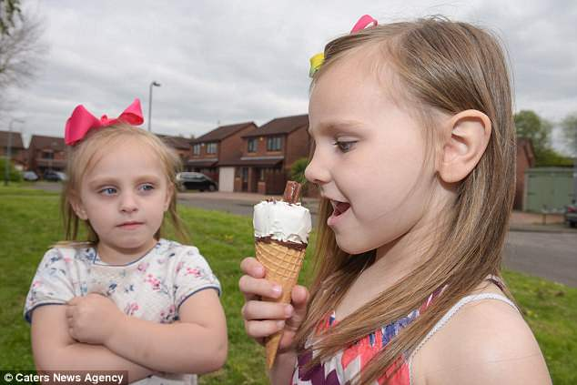 Ms Pickles said: 'Seeing her go through pain and having to have a cautioned life, without being able to enjoy what other children are doing, breaks my heart' (pictured with sister Amelia)