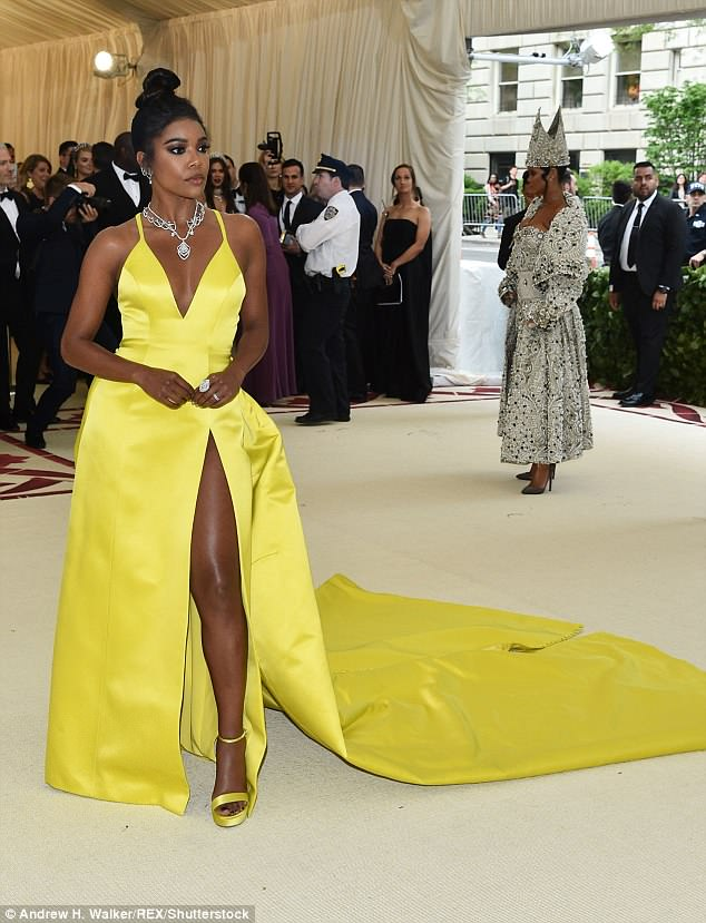 Rihanna, who was one of the hosts at this year's glitzy event, was seen patiently waiting to have her photograph taken as actress Gabrielle Union had her turn on the red carpet