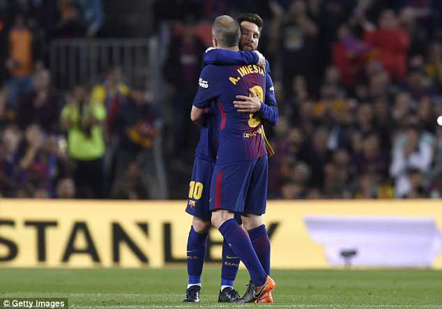 Iniesta embraces Lionel Messi as he is substituted for Paulinho in the 57th minute