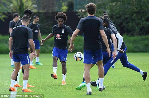 Willian (centre) and his Chelsea team-mates trained on Tuesday ahead of Huddersfield test