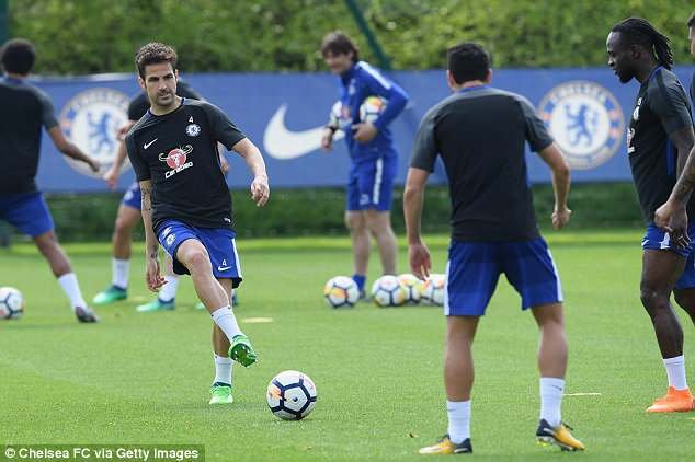Cesc Fabregas (left) hones his passing during a training session at Cobham on Tuesday