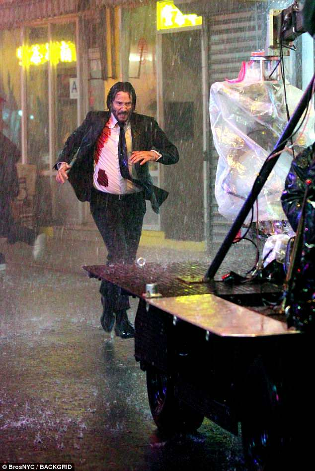 What a day: It certainly seemed to be a challenging day on set as there was a man-made torrential downpour which Keanu had to navigate through