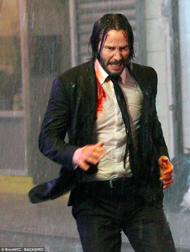 Ouch: No doubt the 53-year-old actor was in the middle of an action-packed scene as he has blood all over his shirt while making a splash in the Downtown Manhattan neighborhood