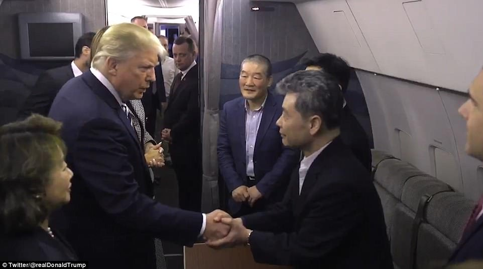 President Donald Trump greets the freed Americans aboard their plane after they landed in Maryland. The image is from a video posted by Trump on Twitter