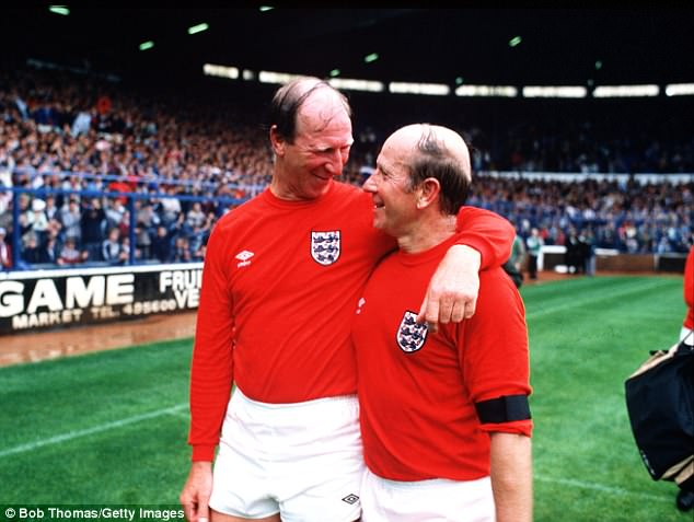 Tommy said he never thought 'in a million years' that he would be following in his brothers' footsteps. Jack and Sir Bobby are pictured at a match in aid of the Bradford fire disaster in July 1985