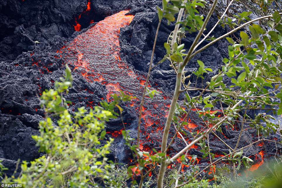 Lava erupts from a fissure east of the Leilani Estates subdivision during ongoing eruptions of the Kilauea Volcano in Hawaii Saturday