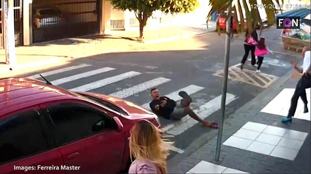 Take down: He had no idea that an armed off-duty police officer was among those on the pavement. Footage shows him falling backwards after being gunned down