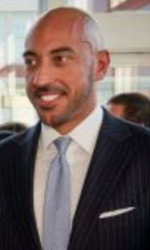 Mother Jones reported that a bald-headed man in the back of two of the images could be Qatari investor Ahmed Al-Rumaihi