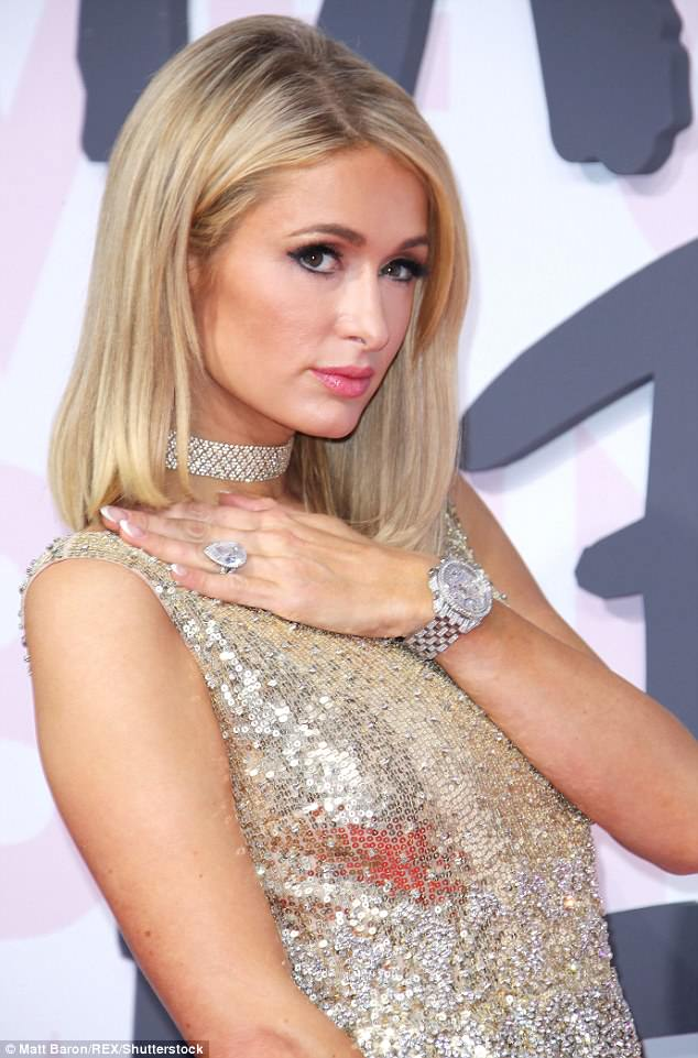 What a rock: The 37-year-old Hilton heiress, who came dripping in diamonds, showed off her 20-carat, pear shaped engagement ring on the red carpet