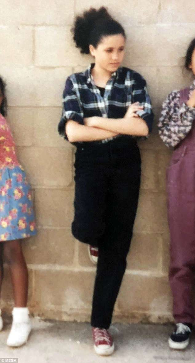 Style of the times: In her early teen years, Meghan wore her hair in natural curls and donned flannel shirts and Converse sneakers