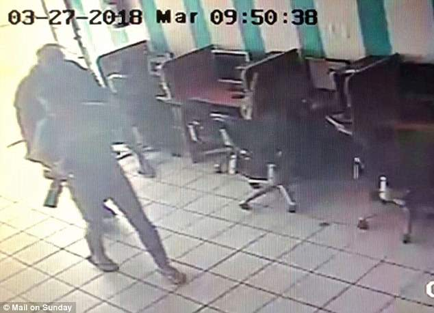 Thomas is seen on surveillance video entering an internet cafe with photographer Jeff Rayner to set up staged photos
