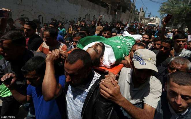 Palestinians rallied in Gaza on Tuesday for the funerals of scores of people killed by Israeli troops a day earlier, while on the Gaza-Israel border, Israeli forces took up positions to deal with the expected final day of a Palestinian protest campaign