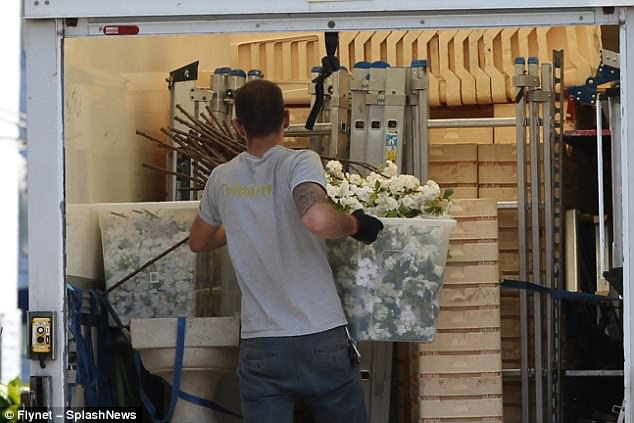 A sneak peak at the wedding décor? Staff were also seen packaging up a large ornamental vase along with dozens of florist buckets