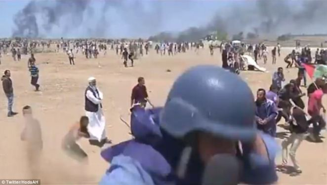 Video shows the network's international correspondent Hoda Abdel-Hamid ducking for cover in front of the camera as a bullet whistled past her