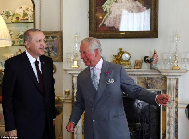 President Recep Tayyip Erdogan met with Prince Charles at his official residence Clarence House this morning (pictured together) - while the angry scenes erupted in nearby Whitehall