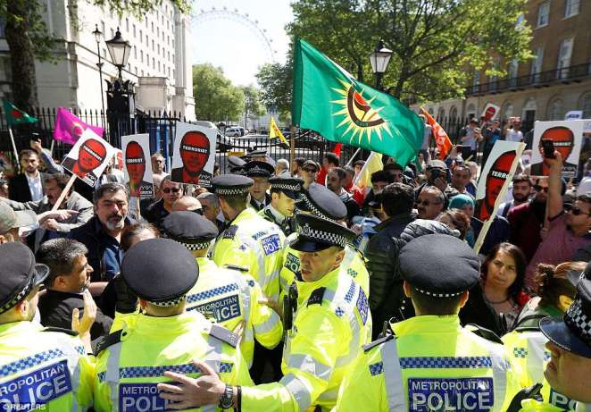 The angry scenes erupted just hours before Theresa May is due to hold talks with President Erdogan at Downing Street