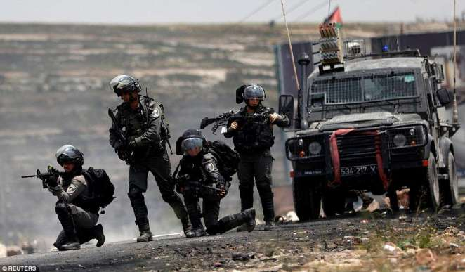 Israeli border police take up positions during clashes Beit El, near Ramallah, West Bank. Violent scenes unfolded during a Palestinian protest marking the 70th anniversary of Nakba