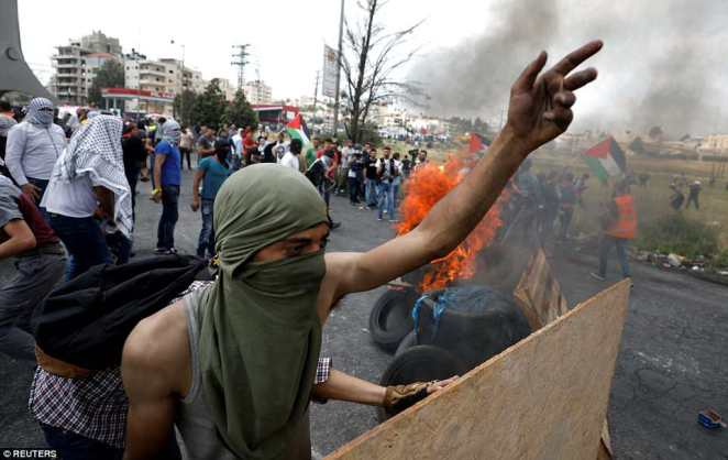Thick black smoke billowed from burning tires as Palestinians threw stones at Israeli troops, who responded with tear gas. About 200 Palestinians were protesting in the biblical city of Bethlehem while another 100 were demonstrating in the Palestinian city of Ramallah