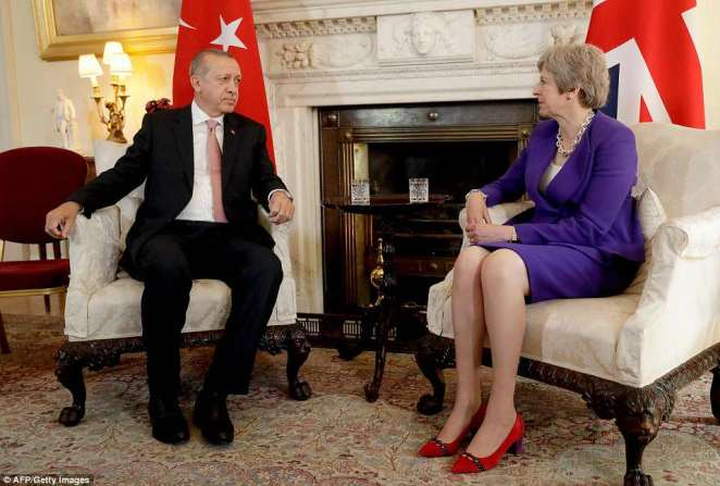 President Recep Tayyip Erdogan attacked Israel and the US after dozens of Palestinians - many unarmed - were killed by Israeli sniper fire during protests yesterday and today, as he sat next to Theresa May in Downing Street today (pictured)