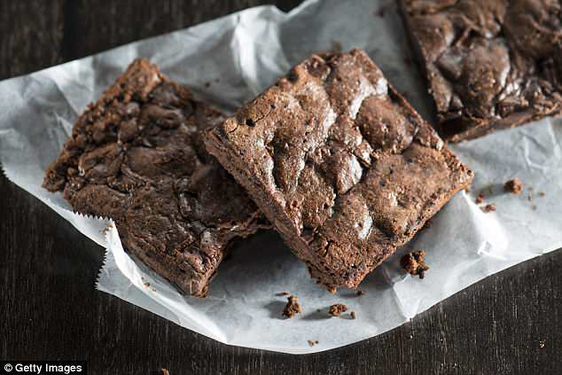 A Michigan engineering company employee has been fired after police determined she baked laxatives into brownies (file image) intended for a departing colleague's send-off