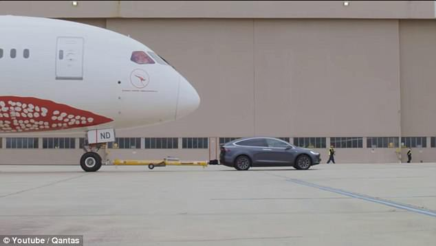 Elon Musk's electric car company shared a video on Tuesday of a Tesla Model X P100D towing a Boeing 787-9 Dreamliner at Melbourne Airport in Australia