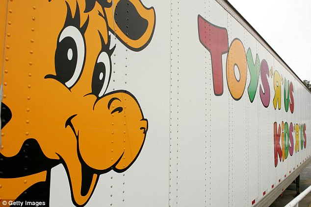 """Geoffrey the Giraffe is seen on the side of a Toys """"R"""" Us truck March 17, 2005 in Colma, California. Toys R Us Inc."""
