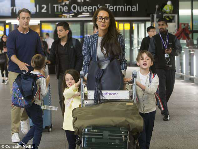 The three children of Meghan's best friend Jessica Mulroney - twins Brian and John, seven, and daughter Ivy, four - are pictured with their mother arriving at London Heathrow Airport today