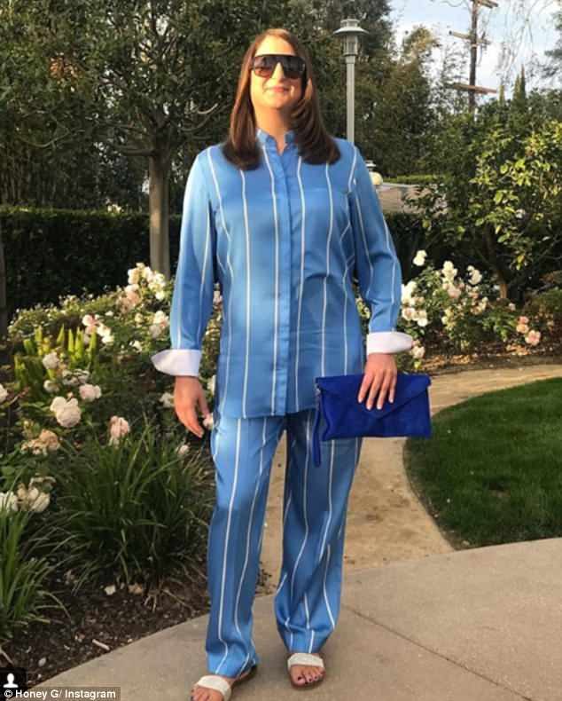 Quite a difference: The rapper has revealed her new look in a series of Instagram shots, including one in which she wears a sophisticated striped blouse and matching trousers from high-end designer Victioria Beckham