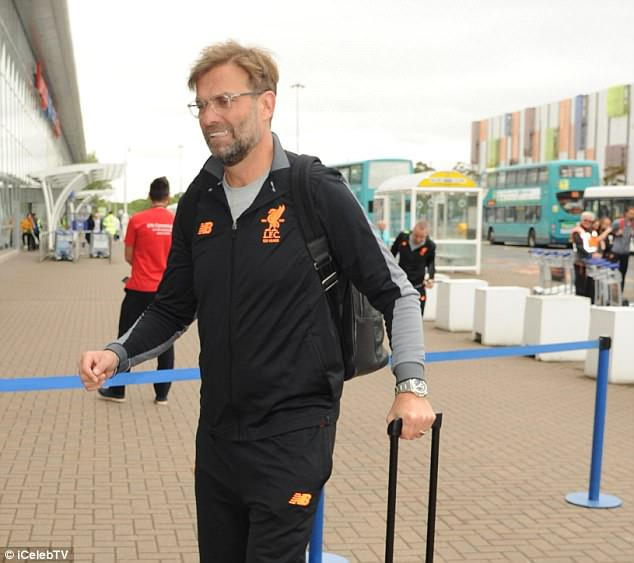 A smiling Jurgen Klopp led his players into the airport ahead of their training trip to Marbella
