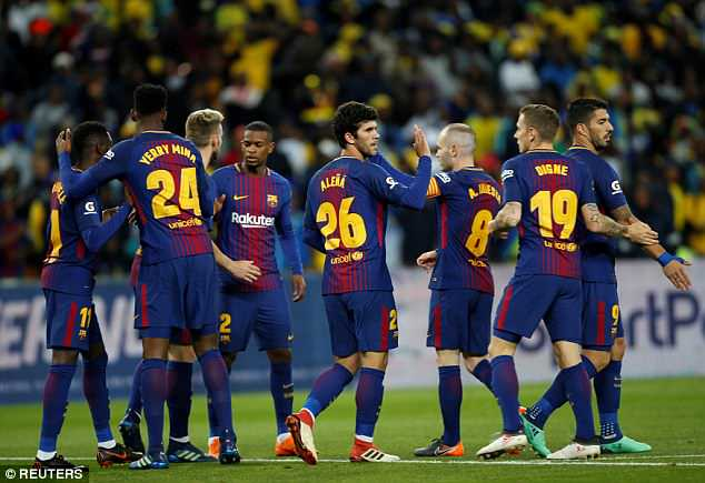 Barcelona celebrate after scoring the opening goal in the Nelson Mandela Centenary Cup