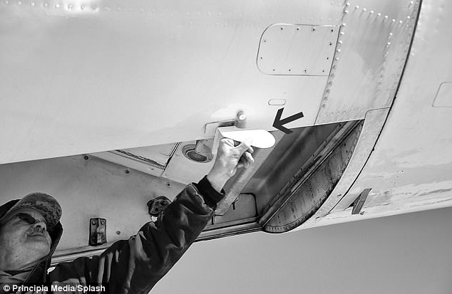 Airline maintenance worker demonstrates the 'Cooper vane', installed in all 727 airplanes following the hijacking