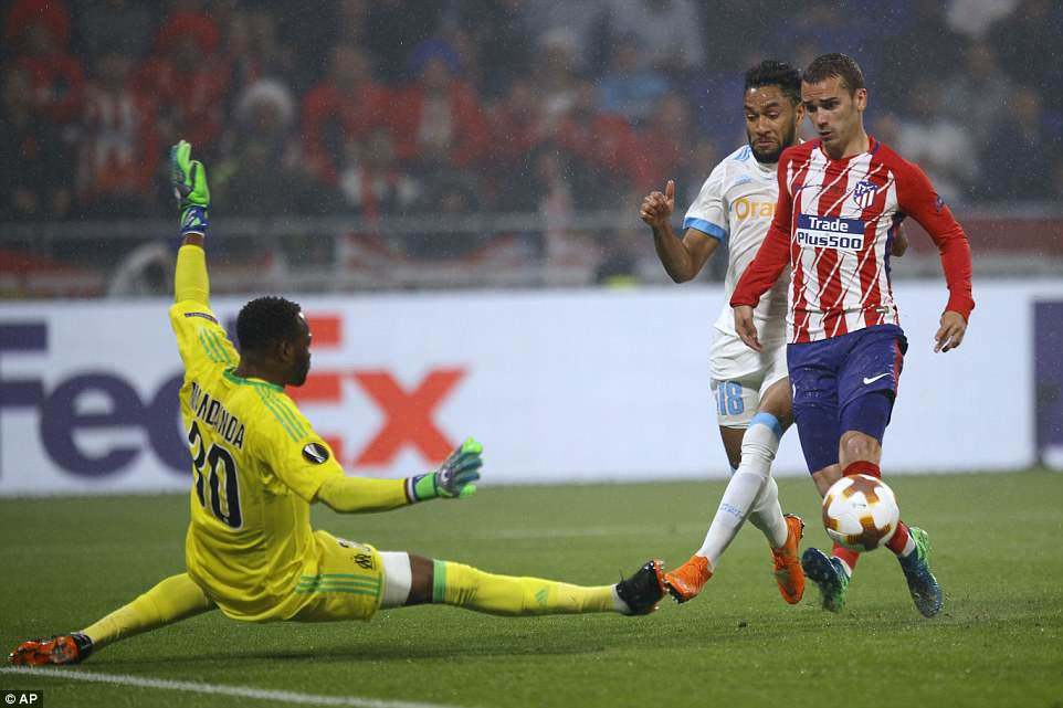 Griezmann chips over a diving Mandanda to double Atletico Madrid's lead and put them in touching distance of the final