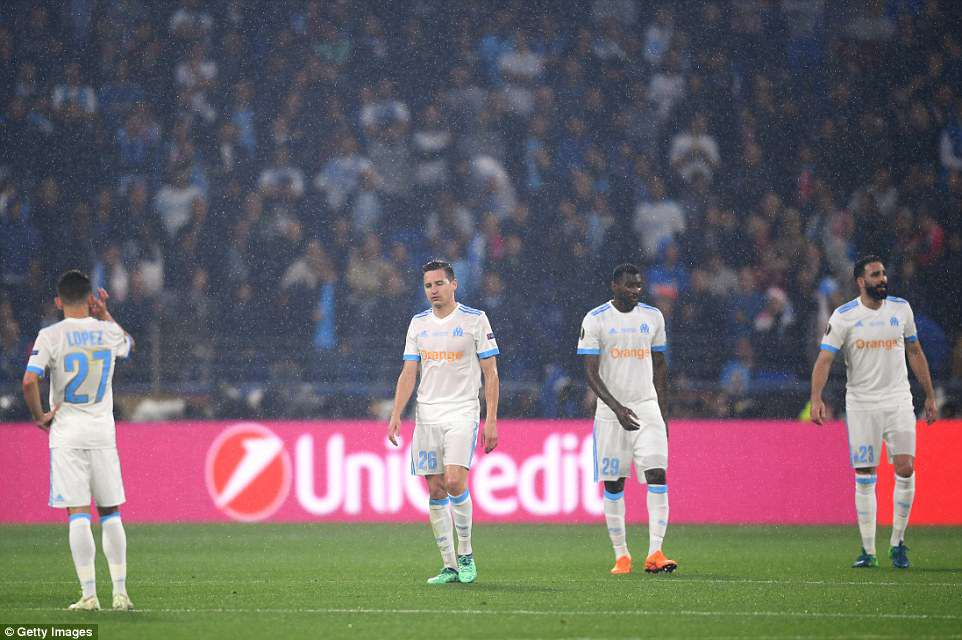 Marseille players look dejected after conceding a second goal to Atletico Madrid in Wednesday's Europa League final