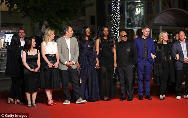 "(L-R) Producer Vanessa Tovell, Lara Chinn, producer Simon Chinn, producer Pat Houston, Rayah Houston, Ulysses Carter, director Kevin Macdonald, producer Lisa Erspamer and producer Jonathan Chinn attend the screening of ""Whitney"" during the 71st annual Cannes Film Festival"