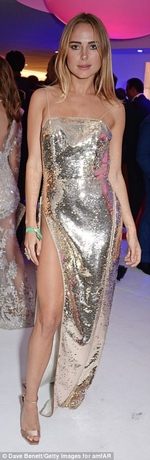 All eyes on her:Kimberley Garner went underwear free while wearing this sequin dress her at the amfAR Gala after-party at the Hotel du Cap-Eden-Roc, Cannes, on Thursday