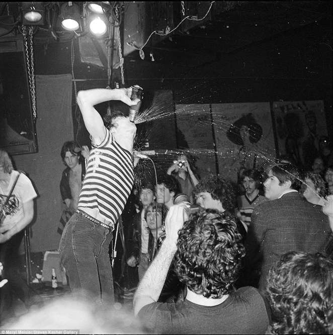 CBGB, which stood for Country, Bluegrass and Blues, stayed open for decades at 315 Bowery until closing in 2006 due to increasing rent and gentrification. Pictured above is another photo captured by Meisler that's never been published showing The Dead Boys during a performance where they sprayed beer on the crowd at CBGB in March 1979