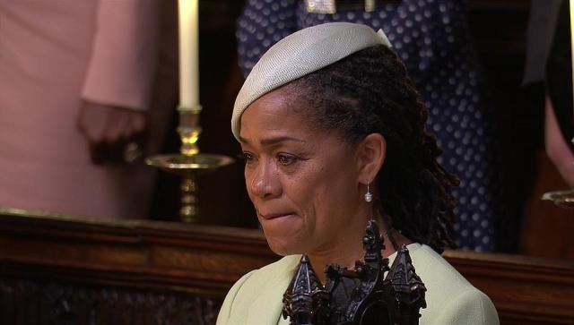 The mother appeared to shed a tear after escorting Meghan to the church before leaving her to walk down the aisle