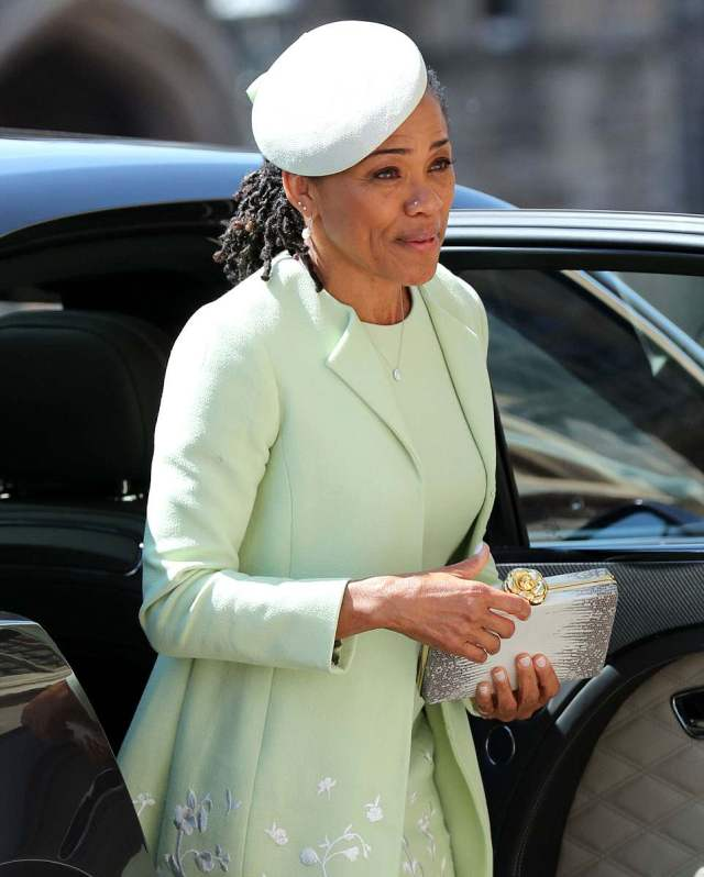 The mother of the bride stunned in a lime green dress and matching coat by Oscar De La Renta