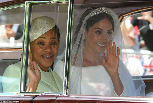 Doria appeared to fully embrace the experience waving to well-wishers from the car
