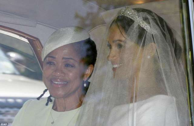 The mother-of-the-bride escorted her daughter Meghan Markle to her wedding