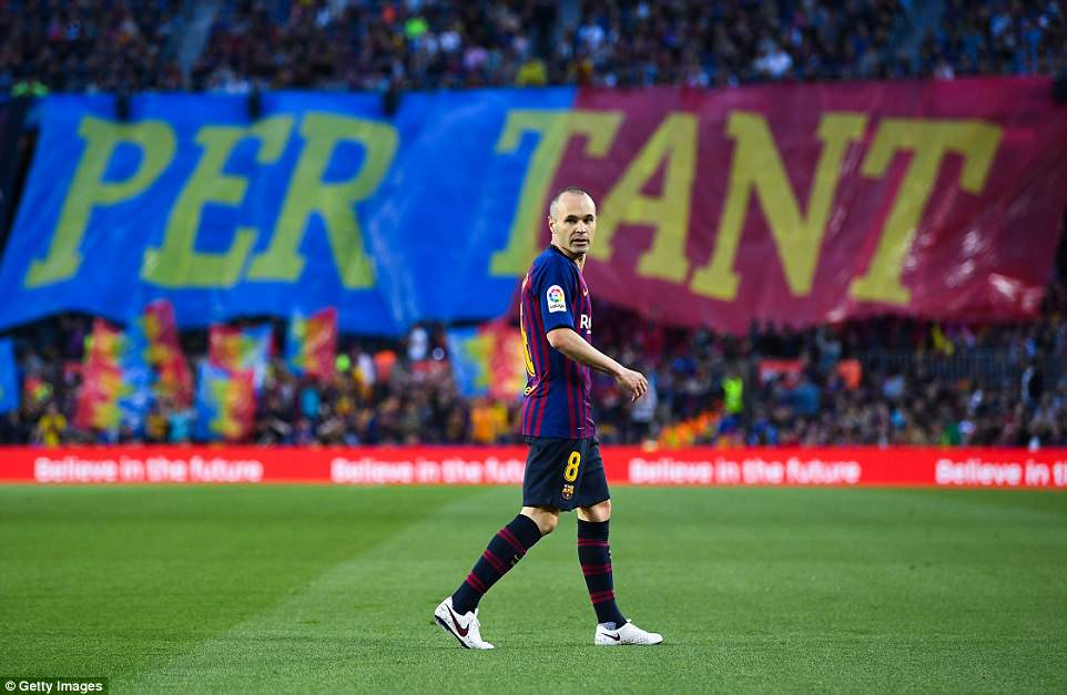 Iniesta looks on as the Barcelona supporters held up banners in recognition of his services to the Spanish club