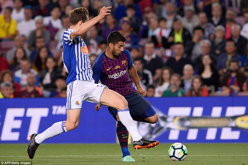 Suarez (right) attempts to get past Sociedad defender Diego Llorente as his team looked to end their season on a high