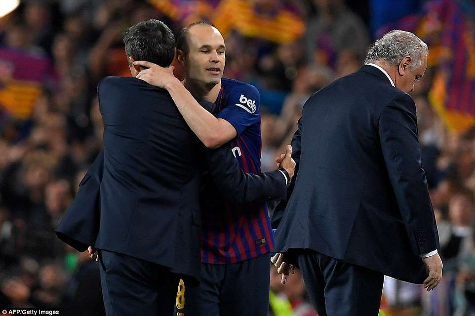 Iniesta (centre) hugs Barcelona manager Ernesto Valverde (left) after being replaced by Paco Alcacer in the 82nd minute