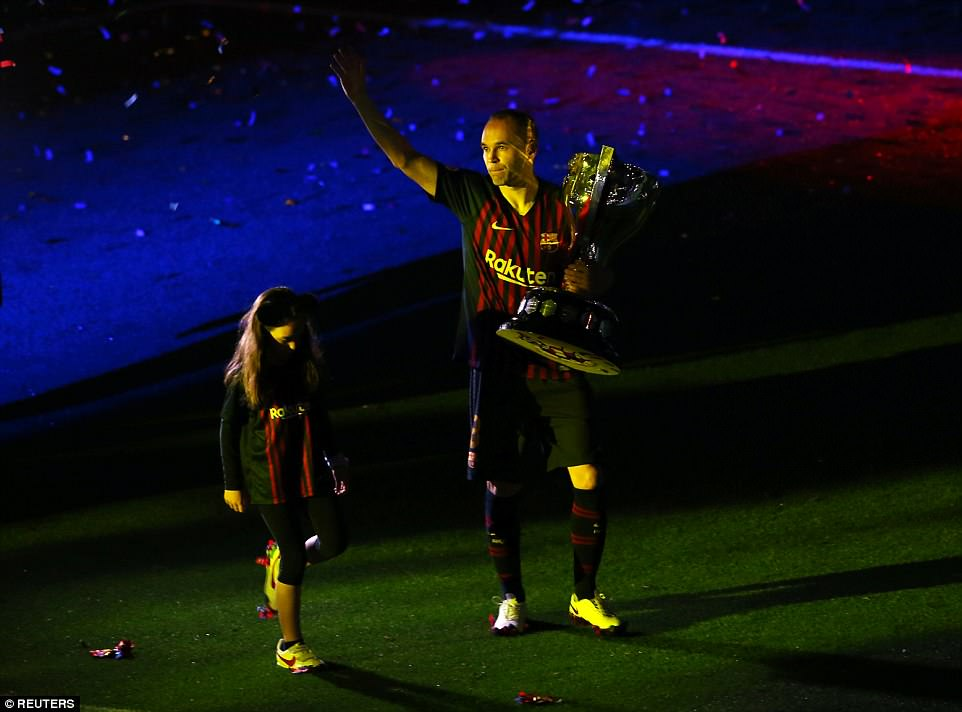With Barcelona's colours illuminating a stadium plunged into darkness, Iniesta enjoyed a lap of honour with his family