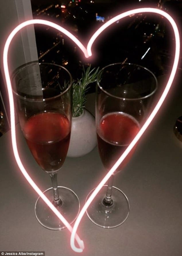 So romantic: From their eatery, Jessica posted a heart-framed snapshot of their drinks, in front of a dazzling view of the Los Angeles cityscape by night