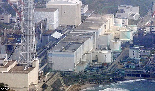 Pictured is an aerial view of the reactors of the tsunami-stricken Fukushima Dai-ichi nuclear power plant stand in Okuma, Fukushima