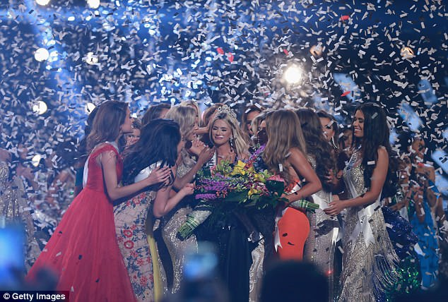 Fellow contestants congratulate the new Miss USA, Sarah Rose Summers