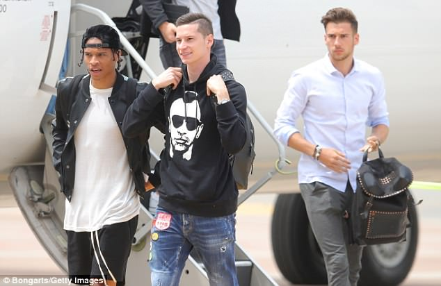 Sane speaks to Julian Draxler after stepping off their plane on Wednesday afternoon