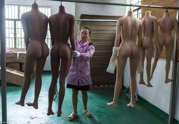 According to the company French customers like robots with blond curly hair, blue eyes and hairless genitals with a natural pink colour. Aworker, pictured, hangs dolls' bodies to dry and checks them in sex dolls factory in Dongguan